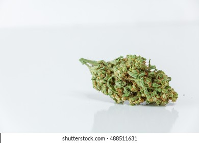 Marijuana Bud, Cannabis, Pot, Weed Close Up Isolated On White Background. Selective Focus. Copy Space.