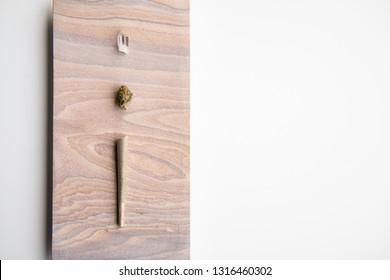 Marijuana Bud, Joint and Crystal on a Desert Stone, Landscape Orientation - Minimalist Cannabis