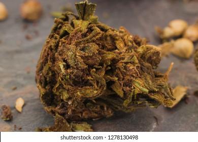 Marijuana bud on a sone table