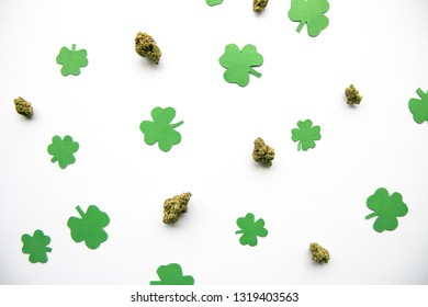Marijuana Buds against Four and Three Leaf Clovers St Patricks St Pattys Day - Top Down, Left Aligned View