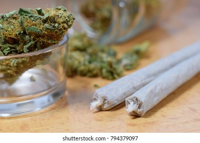Marijuana buds, jar and joints on the table
