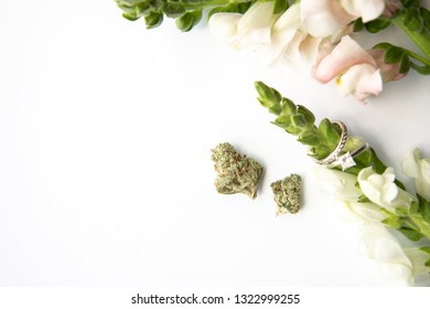 Marijuana Buds next to Diamond Wedding and Engagement Ring Around Flowers - Cannabis Wedding