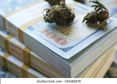 Marijuana Buds On Stacks of Ten Thousand Dollar Bundles High Quality