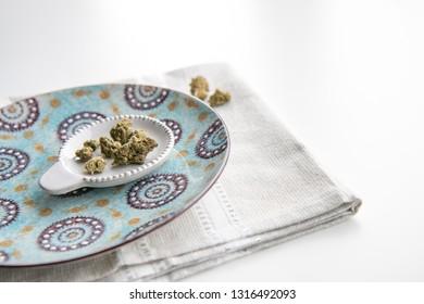 Marijuana Buds on a Vintage Plate atop a White Background Minimalist Cannabis