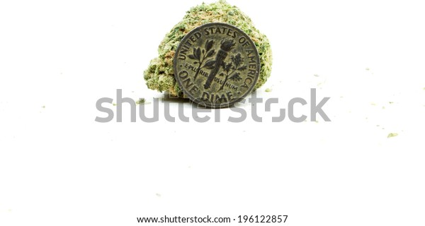 Marijuana and Cannabis Bud with Coin, Dime on White Background.
