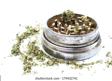 Marijuana and Cannabis Bud in Metal Grinder on White Background