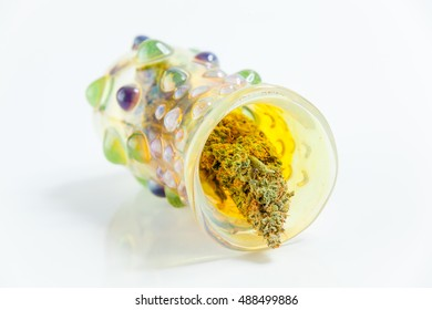 Marijuana Cannabis Buds Close Up In Decorative Glass Jar Isolated On White Background. Selective Focus. Copy Space.