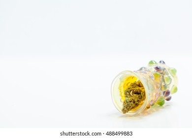 Marijuana Cannabis Buds In Decorative Glass Jar Isolated On White Background. Selective Focus. Copy Space.