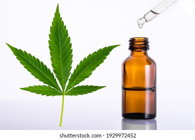 Marijuana or Cannabis green leaf. Essential oil for aromatherapy. Brown glass bottle with medicine dropper or pipette. Medical marijuana sativa or indica. Organic cannabis oils. US Decriminalize weed.
