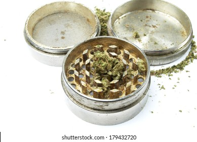 Marijuana and Cannabis in Metal Grinder on White Background