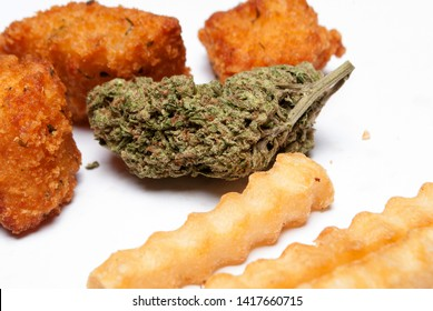 marijuana and cannabis munchies and unhealthy fried junk food on white background