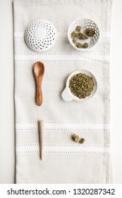 Marijuana Cannabis products on top of a silver placemat. Minimalist Cannabis