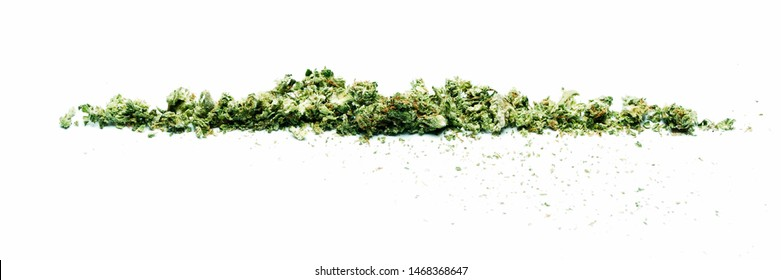 Marijuana and Cannabis Shake. Broken up Dried Weed and Pot. White Background Panorama.