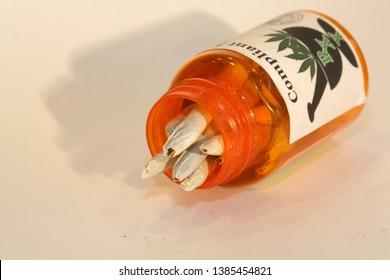 Marijuana Cigarettes. Pre Rolled Marijuana Joints. Isolated on white. Room for text. Recreational Marijuana. Medical Marijuana or Cannabis.