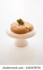 Marijuana Edible Chocolate Chip Cookie on a Pedestal with Cannabis Bud on Top