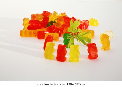 Marijuana edibles. THC and CBD infused Gummy candy jellies. Isolated on white. Room for text. Medical Marijuana Edibles.
