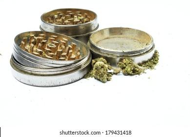 Marijuana and Grinder on white  background