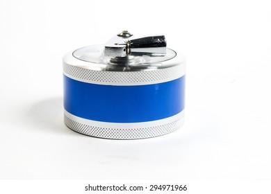 Marijuana grinders on white background