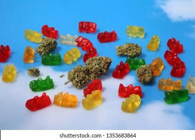 Marijuana Gummy Bears. Marijuana or Cannabis infused gummy candies. THC infused Gummies. CBD Infused Jellies. Blue Sky background. Room for text.