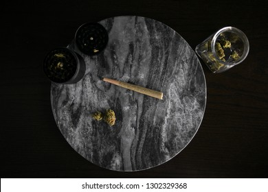 Marijuana Joint, Buds and Grinder on Dark Marble Luxury Cannabis