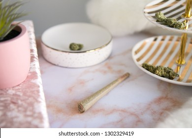 Marijuana Joint and Buds on Pink Marble Vanity Luxury Cannabis
