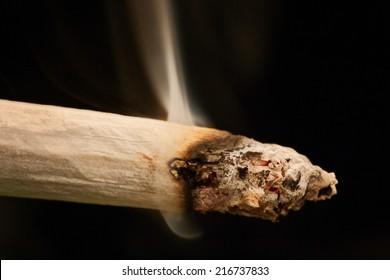 Marijuana joint cigarette smoking closeup