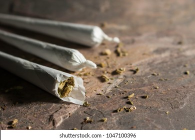 marijuana joints on a stone table