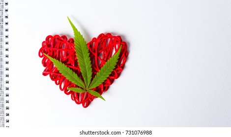 Marijuana leaf on a heart shape in notebook page