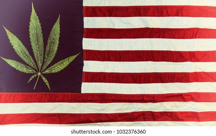 Marijuana leaf on an old American flag. Cannabis legalization in the United States of America.
