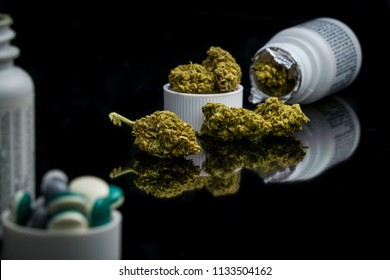 Marijuana legalization recreational and medical cannabis on mirrored black reflection background with bottle of pills with cap full of capsules and pain pills and opioids. Cannabis over flowing