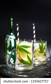 Marijuana lemonade cocktail with ice in a jar