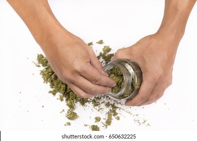 Marijuana medicinal,Hands caring for marijuana in a bottle glass for medicinal and recreational treatment, happiness and tranquility. White background