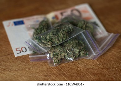 marijuana is on the banknote of fifty euros. cannabis is packaged in packets.