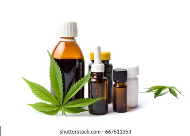 Marijuana plant and cannabis oil bottles isolated