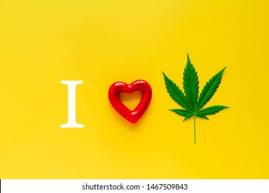 marijuana and red heart on a yellow background, i love marijuana concept