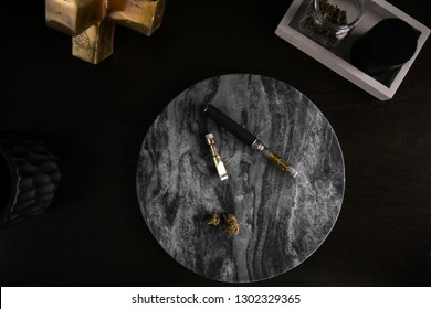 Marijuana Vape Pen and Concentrate on Dark Marble Luxury Cannabis