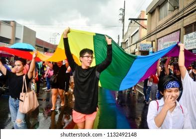 Marikina City, Metro Manila, Philippines - 06/30/18: Themed #RiseUpTogether, members of the LGBTQIA+ community march Marikina streets to commemorate the annual Metro Manila Pride March.