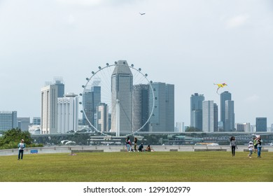 MARINA BARRAGE, SINGAPORE - JANUARY 26: It's a main Dam and multi-purpose attraction. On Rooftop perfect for kite flying as a stunning backdrop of downtown Singapore's architecture on Jan 26, 2019