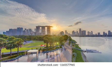 Marina Bay Sands, Gardens by the bay with cloud forest, flower dome and supertrees at sunset timelapse. Top view from marina barrage