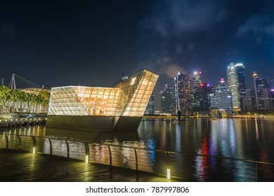 Marina Bay Sands, Singapore - 2017, November 11th: The futuristic building of Louis Vitton Store at night at Marina Bay Sands, Singapore.