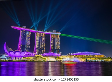 Marina Bay Sands, Singapore - Dec 29 2018: The iconic Marina Bay Sands and ArtScience Museum comes alive at night with a dazzling light show.