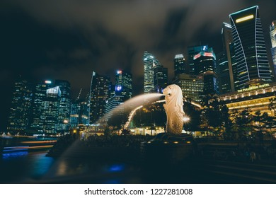 MARINA BAY SANDS, SINGAPORE - OCTOBER 5, 2018: Statue Singapore Merlion in Marina Bay sea. Merlion has a lion's head and fish body and it's spouting water from its mouth.