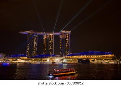 Marina bay sands, SINGAPORE-JUN 14, 2015 : view of marina bay sands with light laser show at night light , Singapore on June 14, 2015