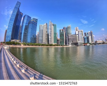 marina bay - Singapore, 27 September 2019: beautiful buildings architecture in Singapore city view with blue skies and reflection