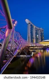 MARINA BAY, SINGAPORE - APRIL 10 - Marina Bay, Singapore - Apr 10 - Marina Bay Sands area and Helix Bridge at dusk on April 10th 2014