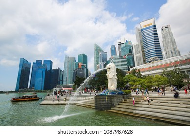 Marina Bay, Singapore - April 13, 2018: The Merlion, unofficial mascot of Singapore, half-fish and half-lion, at Marina Bay with the Singapore skyline in the background.