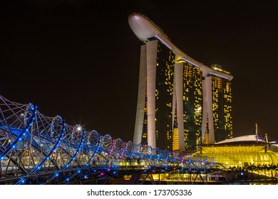 MARINA BAY, SINGAPORE - DEC 31, 2013: Night view of Marina Bay Sands Resort Hotel in Singapore. It is billed as the world's most expensive standalone casino property.