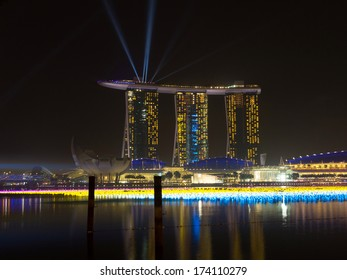 MARINA BAY, SINGAPORE - DEC 31, 2013: Marina Bay Sands Resort Hotel in Singapore. It is billed as the world's most expensive standalone casino property at $8 billion.