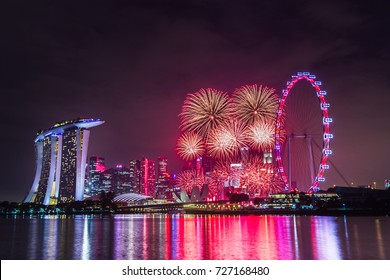 Marina Bay, Singapore - December 31, 2015: Fireworks at the Marina Bay area in Singapore to celebrate the New Year.