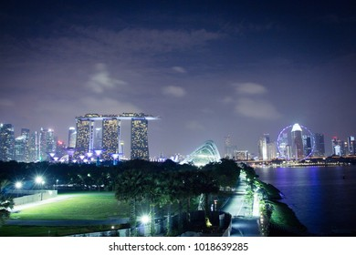 Marina Bay, Singapore - February 4, 2018: The glistering skyline of the popular Marina Bay area taken from Marina Barrage